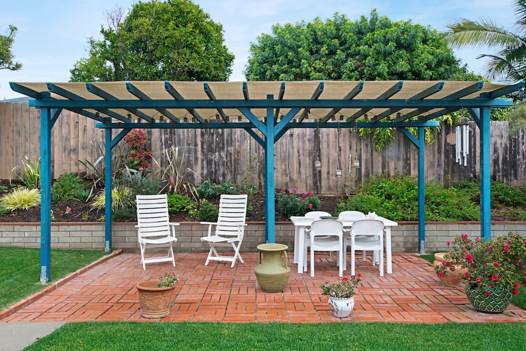 Out the sliding patio doors is the backyard with gorgeous landscaping and pergola