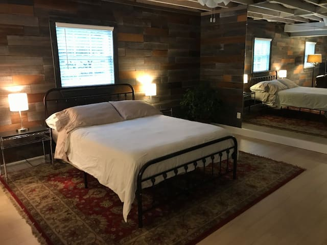 Queen bed and night tables with lamps outfitted with USB ports.