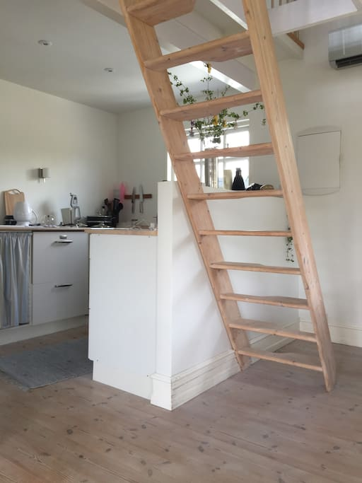 Kitchen and staircase to loft