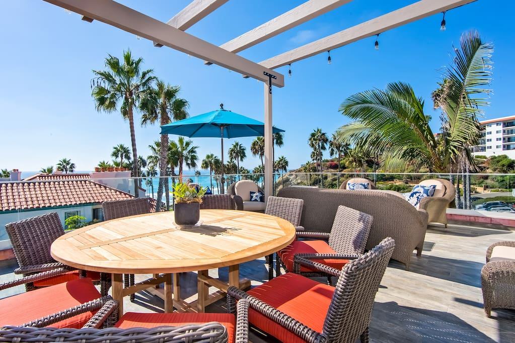 Upstairs patio at big fish features living and dining areas with ocean views.