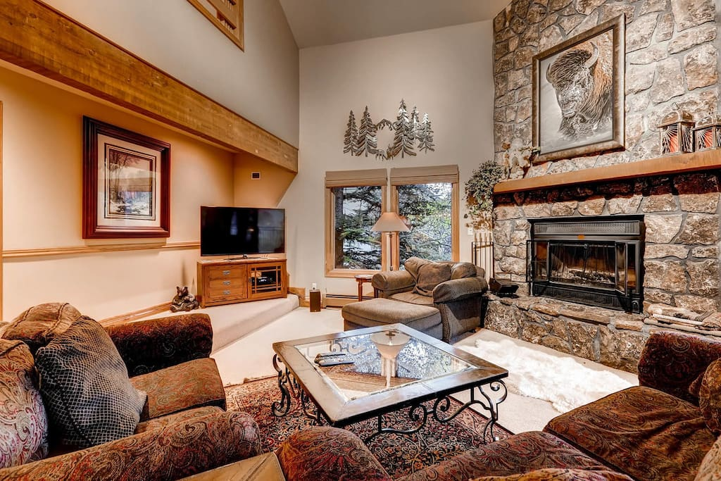 Warm up by the floor-to-ceiling mossrock fireplace and enjoy the 55' Samsung LED HD Smart TV with DVR, Blue Ray Player, HBO, VHS player and selection of DVDs.