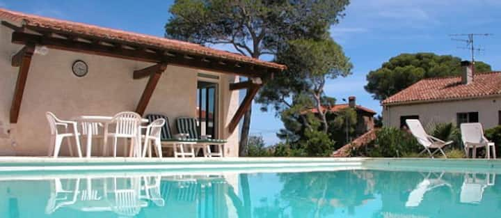 The Poolhouse studio + shared private heated pool