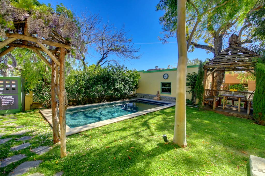 Indulge in this Refreshing Swimming Pool within the Fenced, Secluded Yard