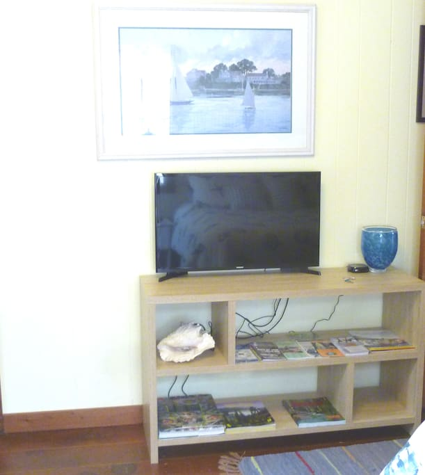 flat screen TV w/brochures and rack cards
