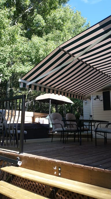 Deck with retractable awning dining table and chairs for tub and 2 loungers.