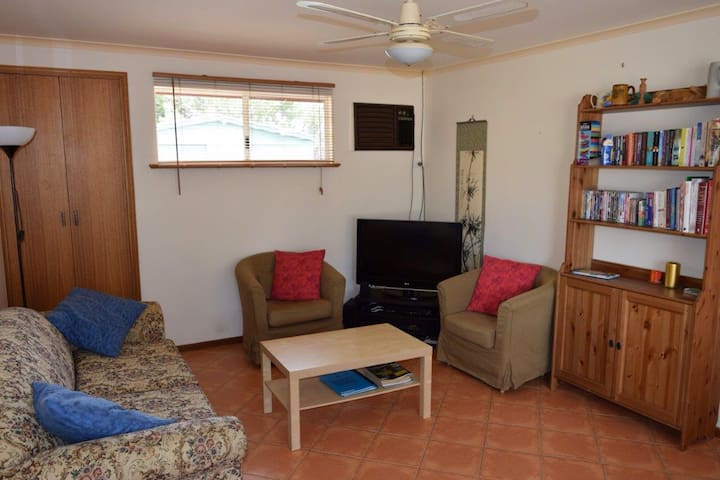 Lounge area has sleeper couch, TV, plenty of board games and a wide selection of books.