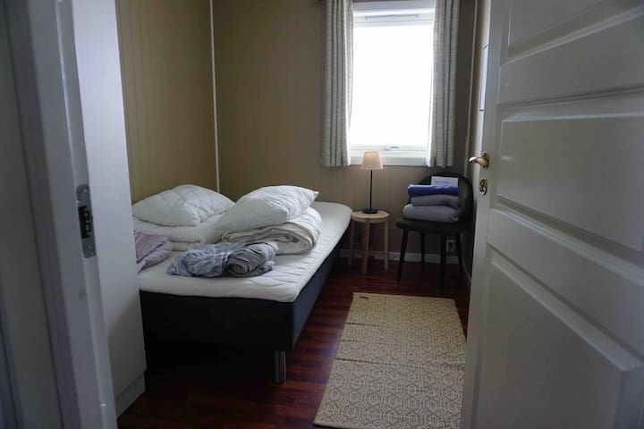 Bedroom for guests. Linens and towels are provided. Small double bed (120cm).