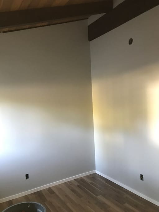 The suites are under construction and will be completed for July bookings. The units are brand new in an older home. This is the main living room.