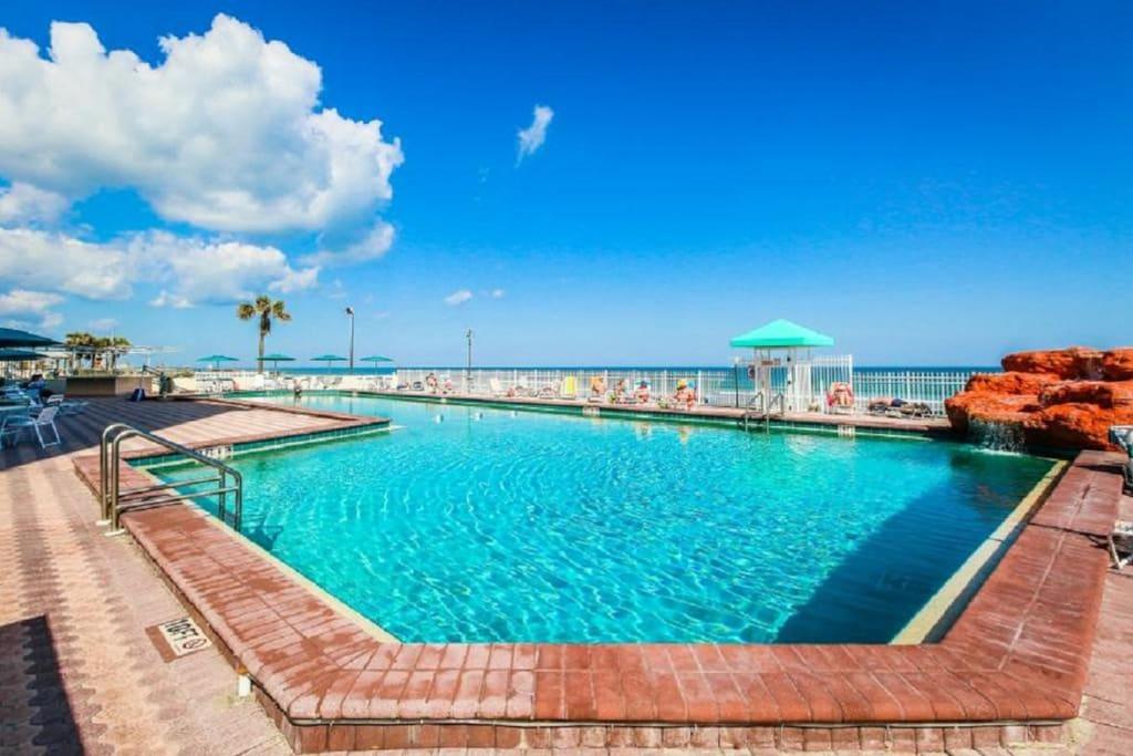 Waterfall feature, 10 foot heated pool, overlooking Daytona Beach.