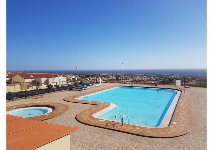 """Holiday Apartment """"Caleta Beach Deluxe"""" with Pool, Wi-Fi, Terrace; Parking Available"""