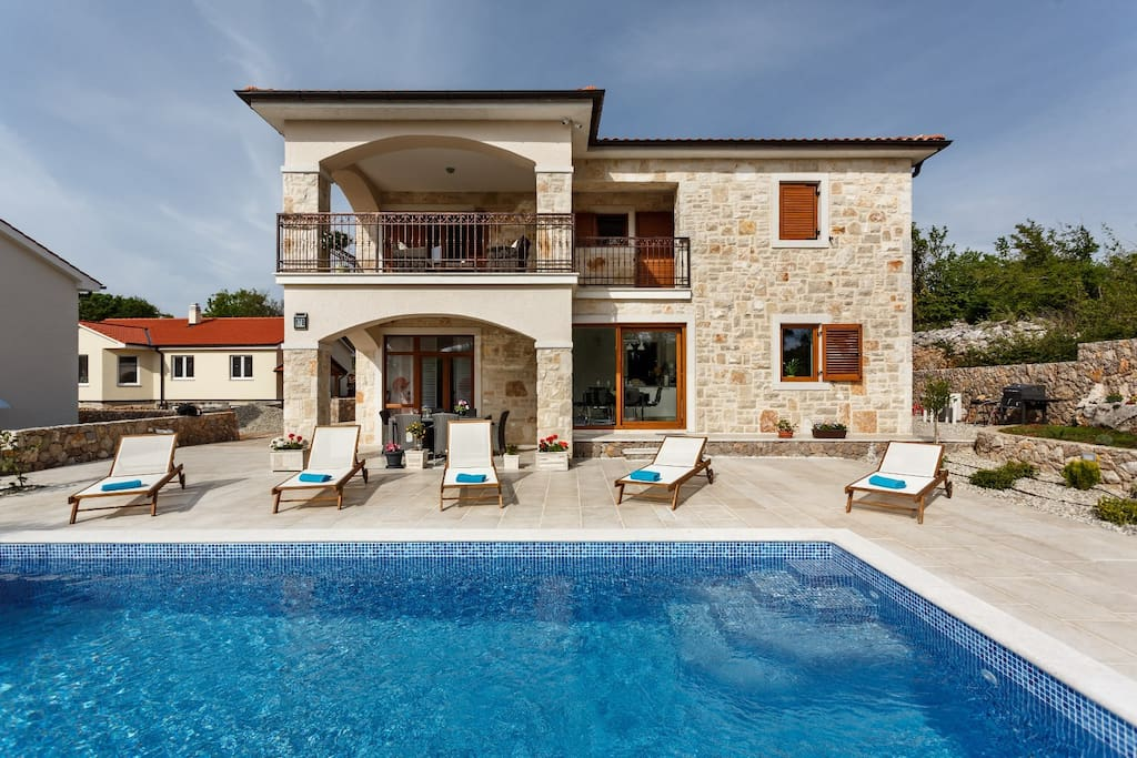 Outdoora view at swimming pool area and Villa