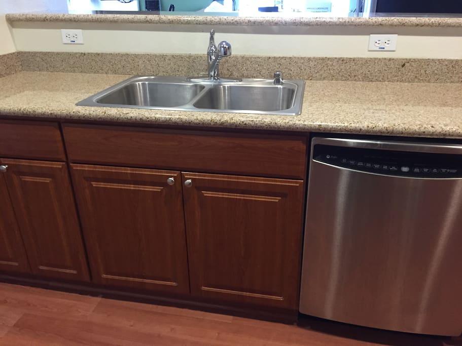 Stainless steel sink Granite countertops Stainless steel dishwasher