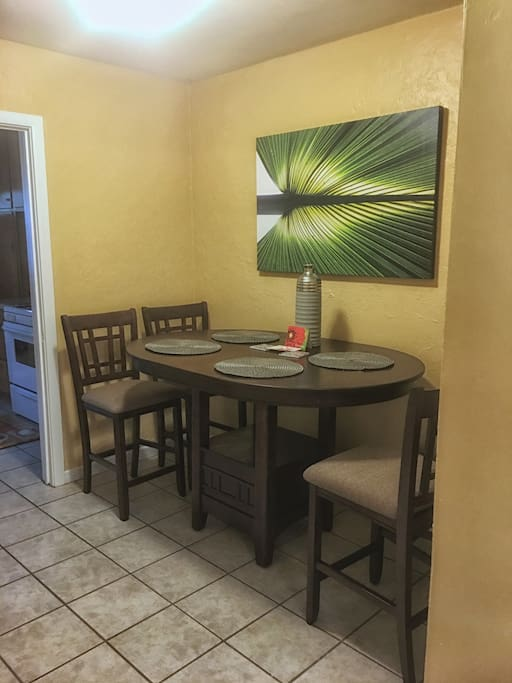 Dining table comfortably seats 4.