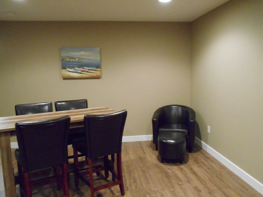 Large rec room downstairs with plenty of seating and large screen television.