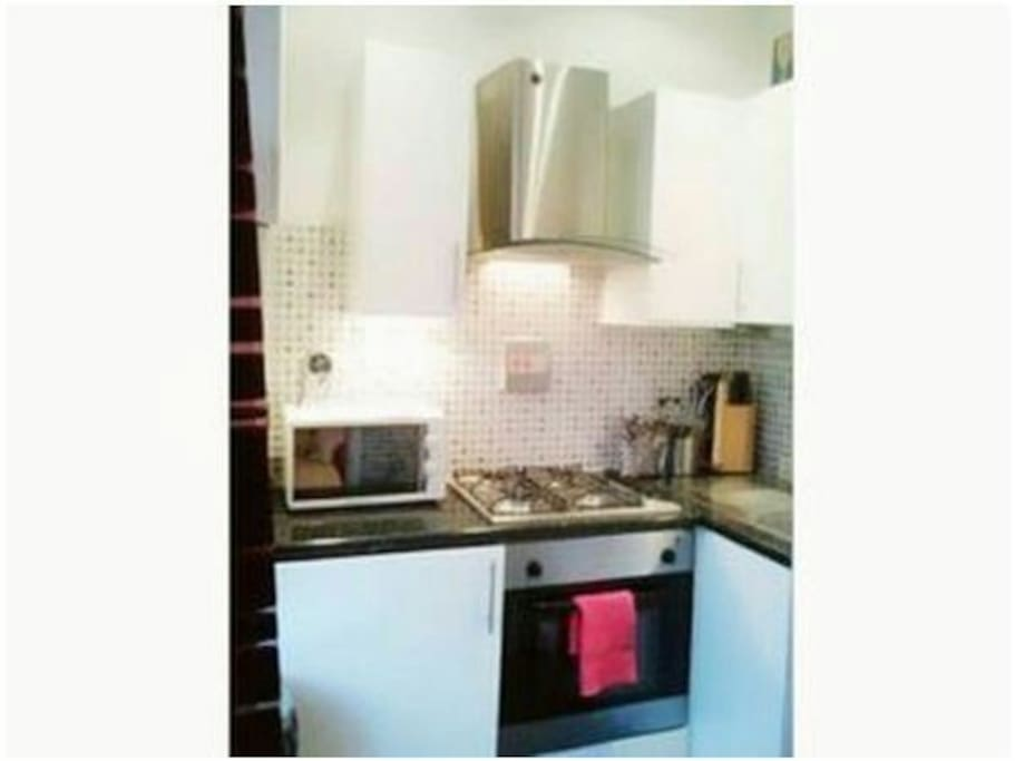 Kitchen with oven, washing machine gas cooling fringe & all you need...