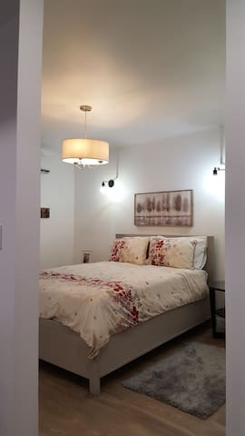 Comfy queen bed and dimmable side lights.