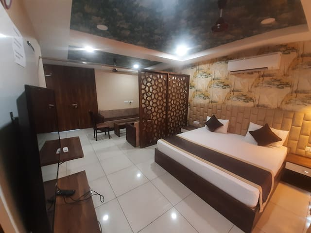 King Size Big Bed 72×75 For your Comfortable Stay With 8to10 Person's Sitting With Partisan. Basic Pentry With Refgrtr Micrwv Sandwch Mkr Ind-Plate Elect Cattle Cutarlies and Tea Coffee Lemon Tea 3×1LTR Water Bottles Light Snacks All Complimentary.