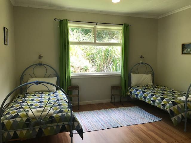 Large third bedroom with two single beds.