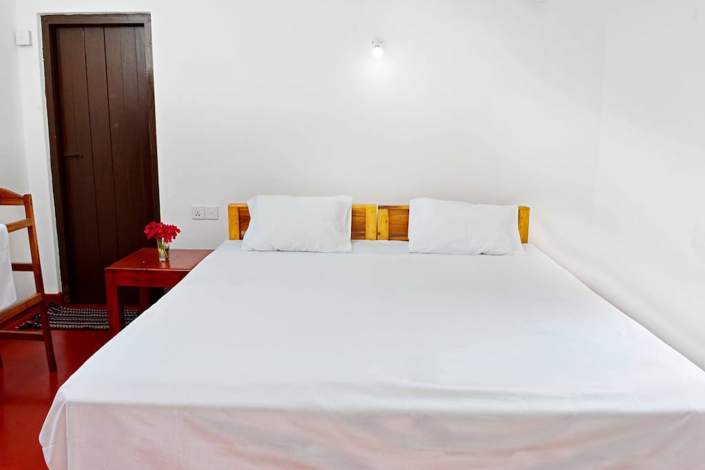 Comfy Double Bed with attached bathroom.