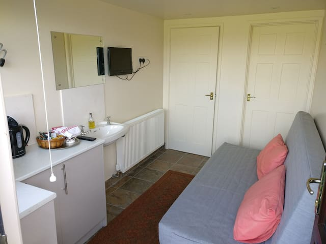 Separate ensuite toilet and shower for your convenience. Towels provided.
