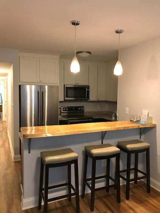Full kitchen with bar stool dining area