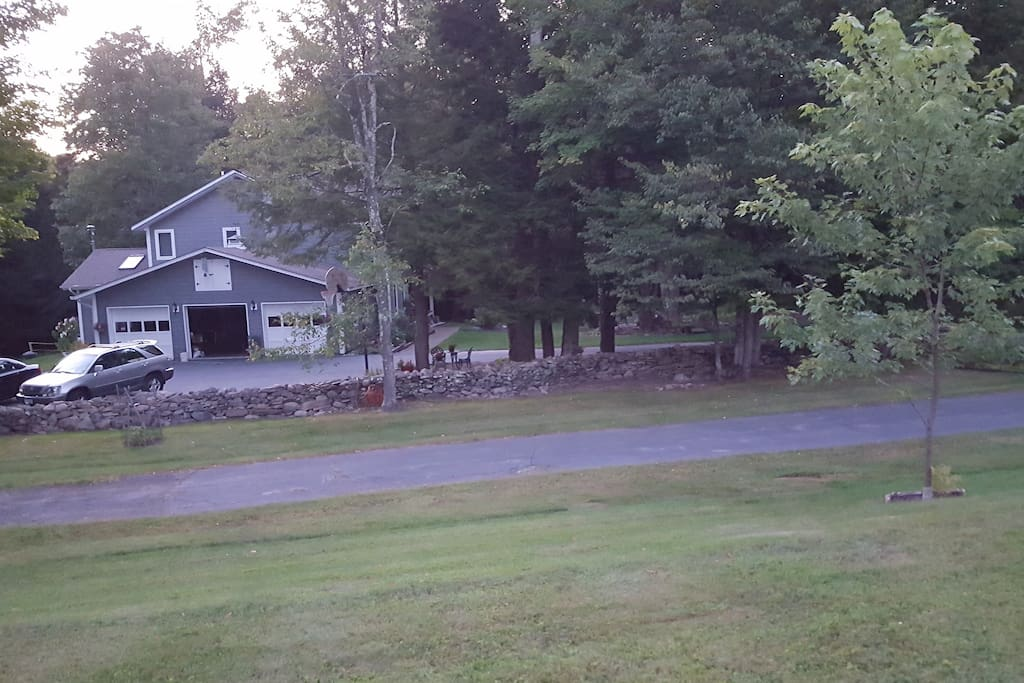 Partly up hill on side of house. The paved area between grass is the other side of our circular drive