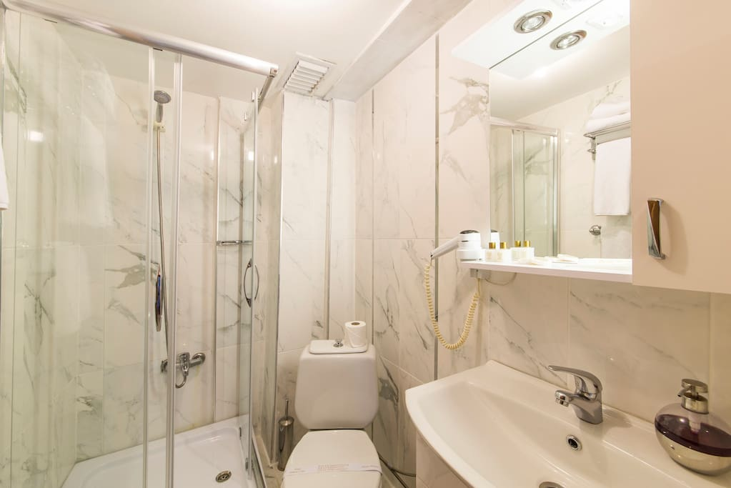 Spacious bathrooms with cabin shower . Complimentary soap, shampoo, slippers, towels, hair-dryer.