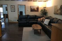 Living room includes a leather sectional with a sleeper sofa.  Includes a Samsung smart TV with internet connection and also a Yamaha 6 speaker home theater system