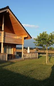 Chambre dans maison en bois - Artigueloutan - Casa