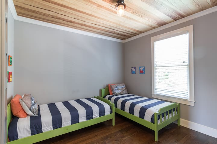 guest room with Caribbean pine ceiling