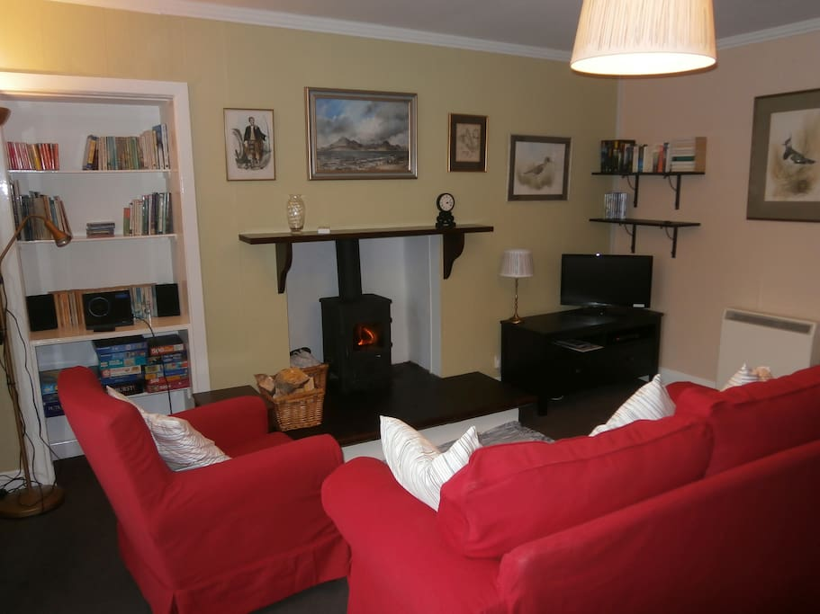Lounge with log burner (all logs included), TV/DVD and plenty of books and local reference guides.