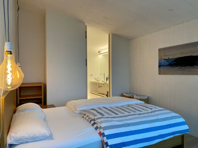 Comfortable bed in a quiet bedroom. As of now, the curtains do not fully block out daylight, consider bringing a mask if you're a light sleeper. On the flipside, nights are completely quiet and you'll love sleeping with the windows open.