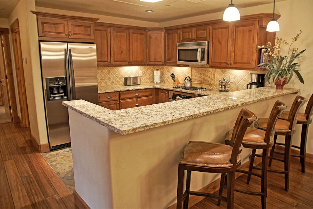 Fully equipped Kitchen with granite counters and bar seating for 4