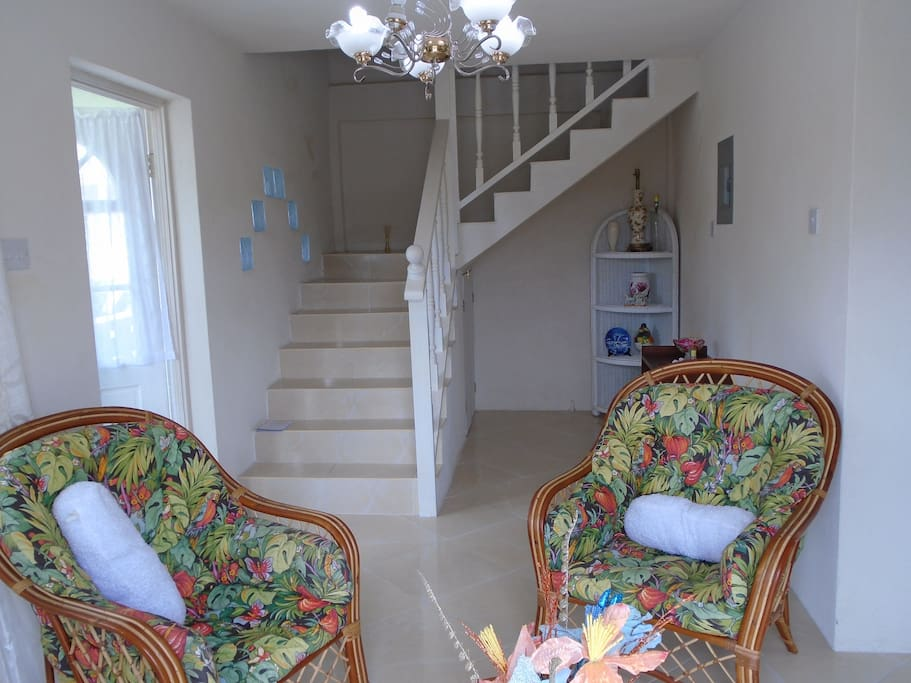 A welcoming interior - the Foyer and a view of the tiled staircase.
