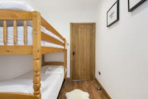 Bedroom 3 - single bunk beds and small drawers.