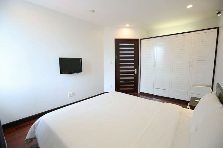 Warmly and nature light come in bedroom with 2 closets