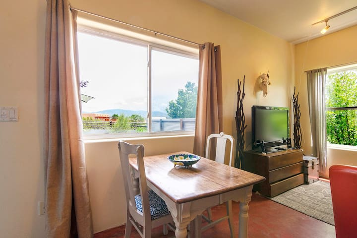 Dining area includes a rustic table and chairs and views of the glorious mountains.