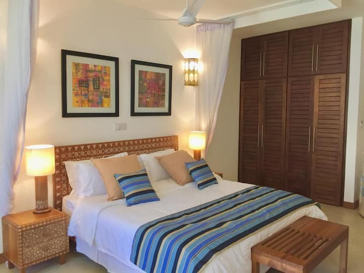 *The African Art Suite* by the beach! King bed!