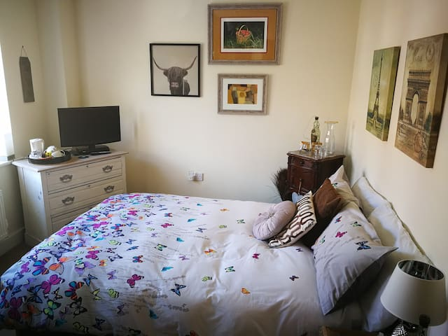 Light and airy bedroom with Freeview TV.