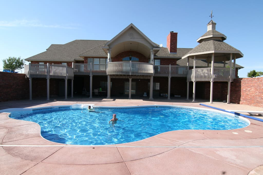 Pool area with fireplace and fire pit