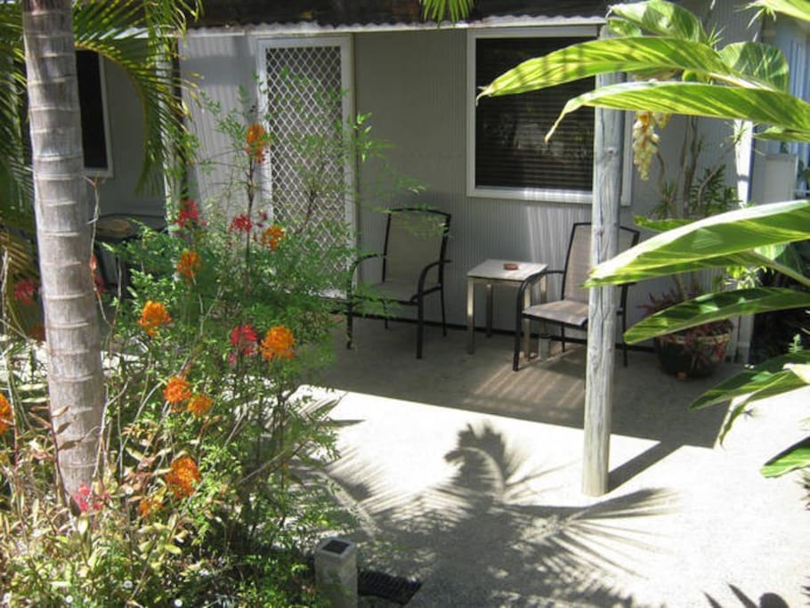 Front entrance - a shady spot in tropical gardens with BBQ