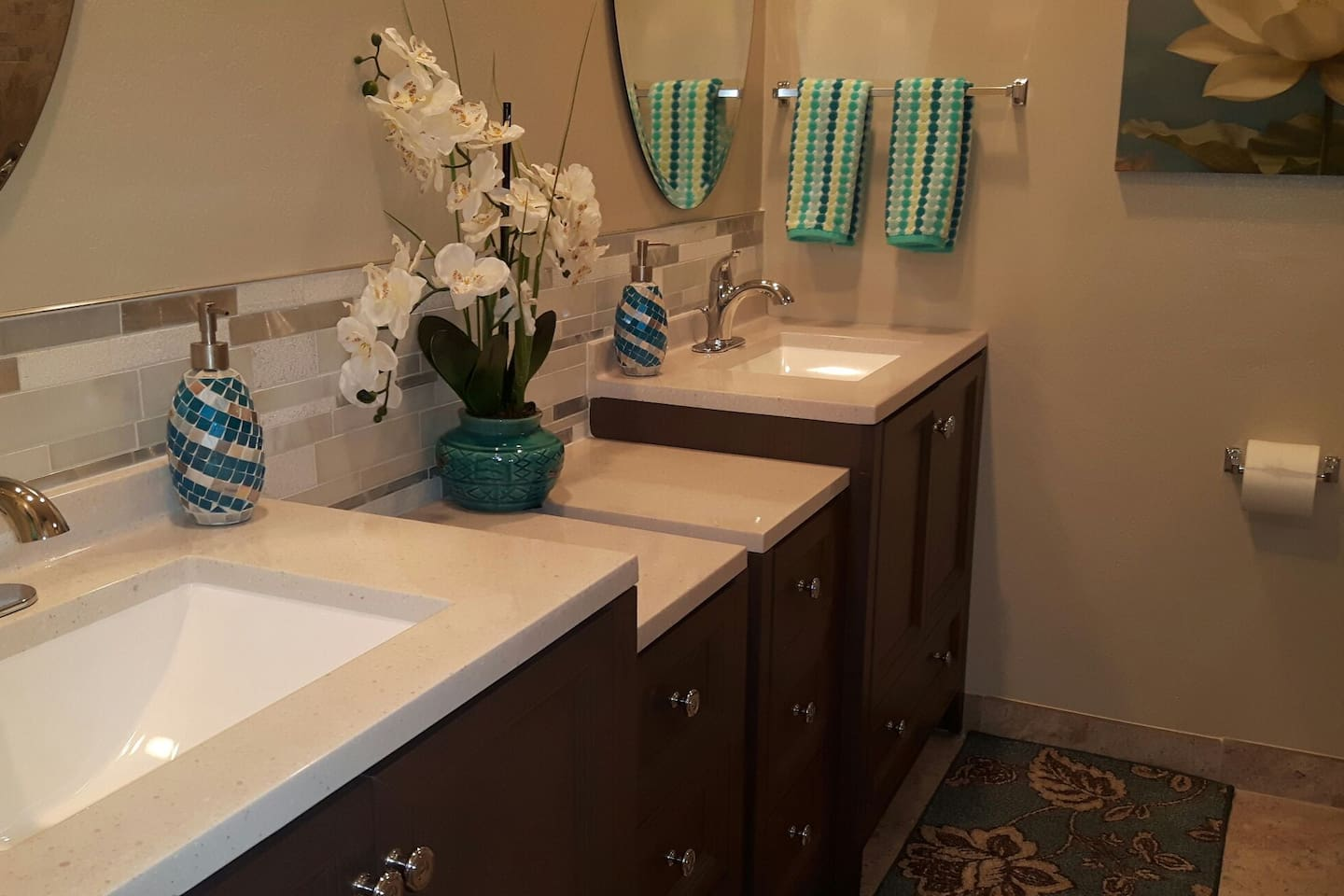 Full sized spa-like bathroom with walk-in shower with double vanities & beautifully tiled walk-in shower