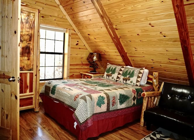 The Loft bedroom has a Queen Size Bed and a Foosball Table.  There is a full size bathroom off the bedroom. This futon is no longer in this cabin.