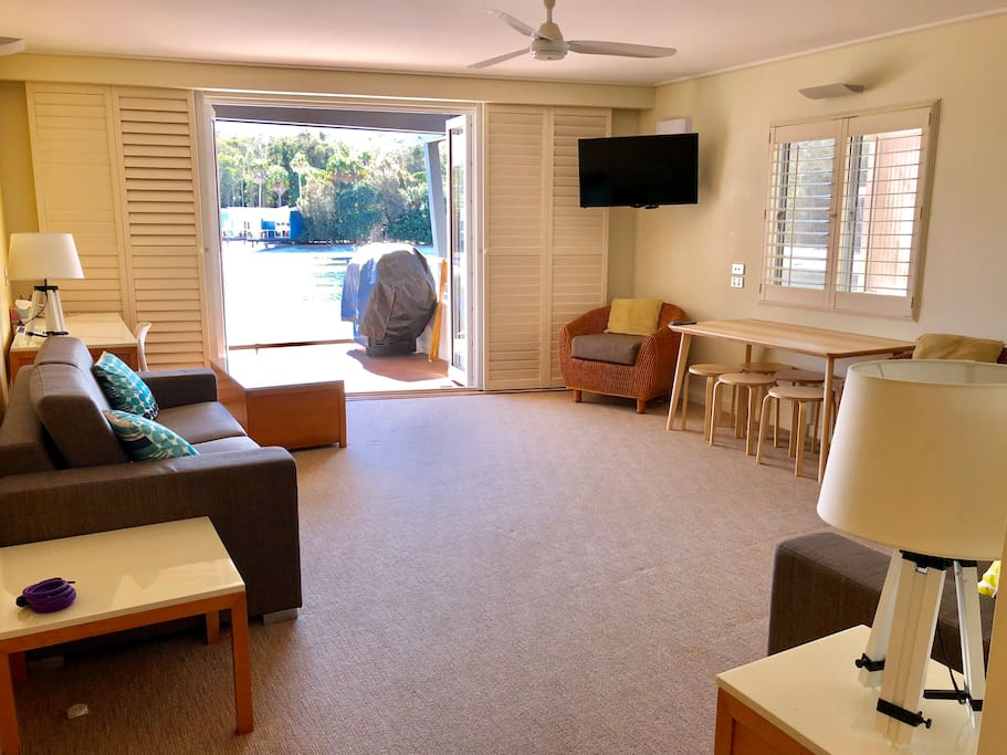 Living area overlooking the beach with new sofa lounges, table and TV. All air conditioned.