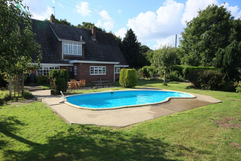With its own private outdoor pool (heated on request - nominal charges) and large rear south facing garden