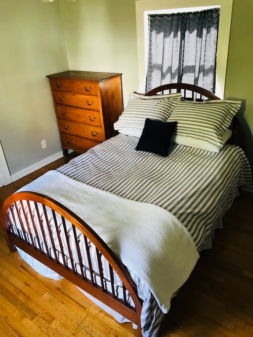 Don't sleep in too late... Queen bed provided with fresh linens. Curtains will help black-out the sun for any naps you'll be taking!