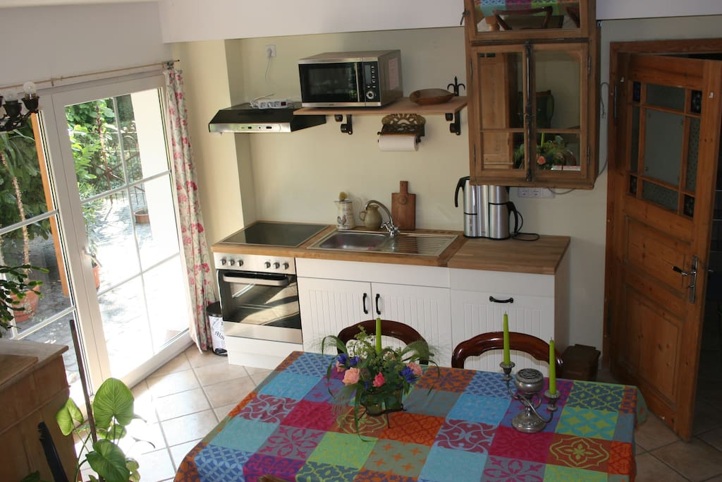 From the small, but convenient kitchen with oven, dishwasher and microwave you have direct access to our country-style garden, which is enclosed.