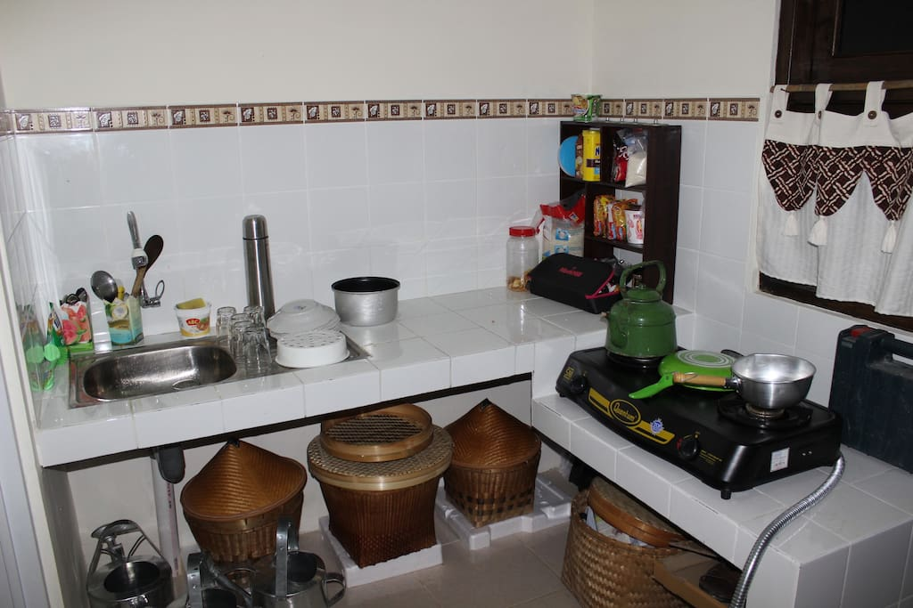 small kitchen, with a sink, a gas stove.