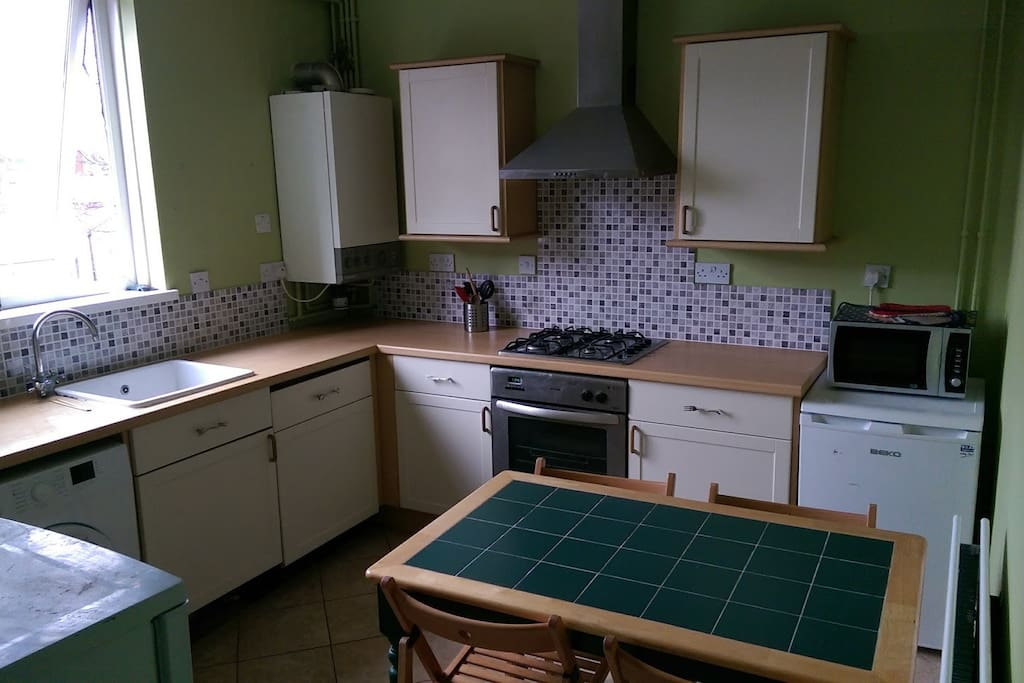 Shared kitchen with regular white goods including two fridges.