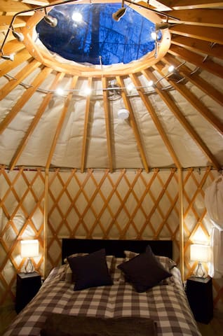 Cozy, queen bed to let guests look through the dome to the sky.